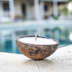 Coconut Shell Candle floats on the water