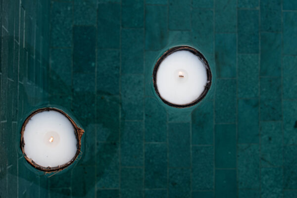 Coconut Shell Candle floats on the water surface